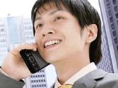 【図: W-ZERO3で直接通話している人の様子】