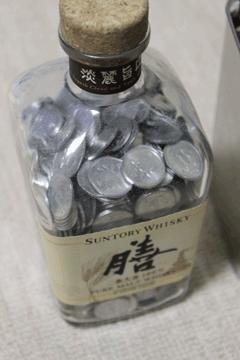 【写真: 1円玉貯金】
